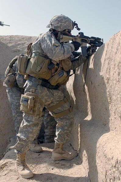 A special operations soldier fires on a Taliban fighting position in the Sangin District area of Helmand Province. April 10, 2007.